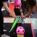 A little girl trying the tail knockdown game